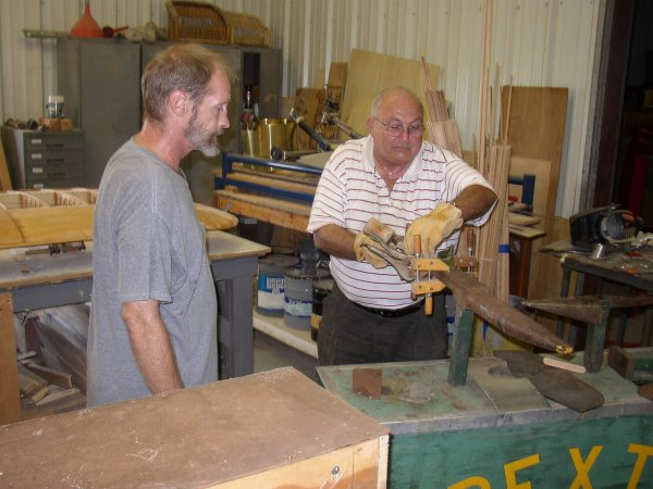 Mike and Sanford working on the windshield