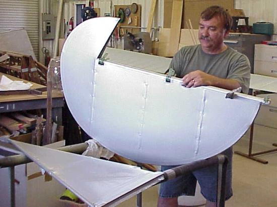 Wayne Jones preparing the rudder for painting