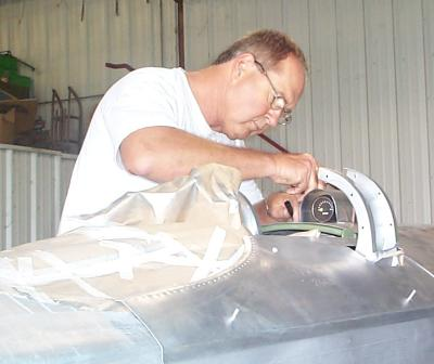 Ted Dawson working 		on the fuel gauge fairing