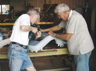 Dick and Ron working 		on the false radiator