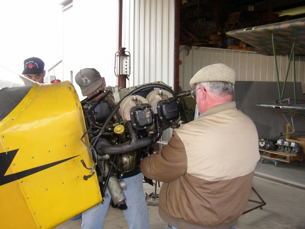 Ted and Mike work on the Cub engine