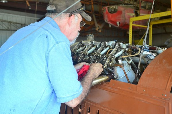 Working on the Canuck's Curtiss OX-5 engine