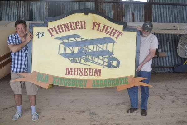 Carl Canga (left) and Dan Siegle holding the new sign